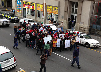 Economic Freedom Fighters - A small march by the EFF on Mandela Day (18 July) 2014 near the parliament building in Cape Town protesting in support of land reform in South Africa.