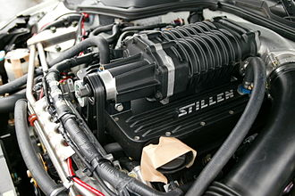 Forced induction - A Roots-type supercharger on a Nissan VQ engine.