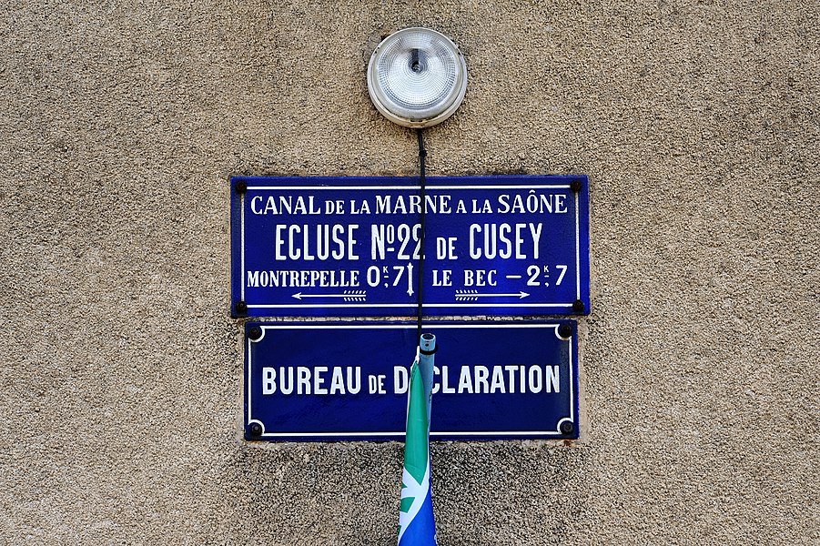 Canal lock No. 22 in Cusey at the Canal entre Champagne et Bourgogne; Haute-Saône, France. Plates at the lock keeper's house.