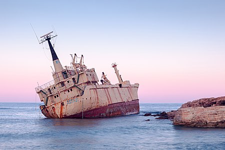 Abandoned rusty cargo ship Edro III near Pegeia, Paphos, Cyprus at sunrise