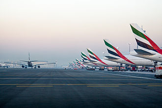 Airline hub - Emirates aircraft at Dubai International Airport