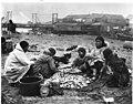 Eskimo women and girls stringing tom cod, Nome, September 5, 1905 (MOHAI 5459).jpg