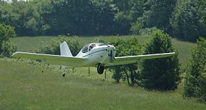 Europa XS -  Rotax 912ULS powered XS takes off showing its single mainwheel and outriggers