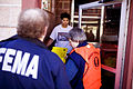 FEMA - 40046 - Community Relations worker speaks to residents in Washington.jpg
