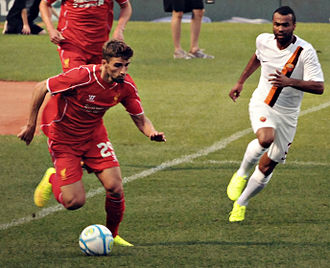 Ashley Cole - Cole defending for Roma against Liverpool in 2014