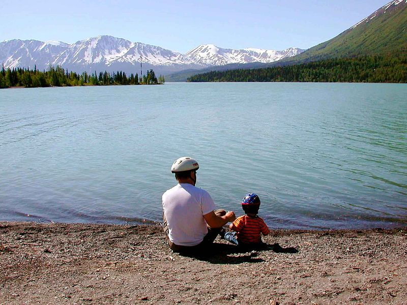 File:Fathers day father with kid on lake.jpg