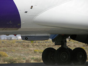 Northrop Grumman Guardian - The Guardian pod mounted on the belly of a FedEx Express MD-11 during flight test.