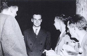 Feynman (center) with Robert Oppenheimer (righ...