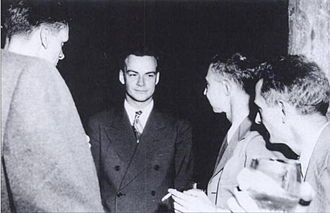 Richard Feynman - Feynman (center) with Robert Oppenheimer (viewer's right, next to Feynman) at a Los Alamos Laboratory social function during the Manhattan Project