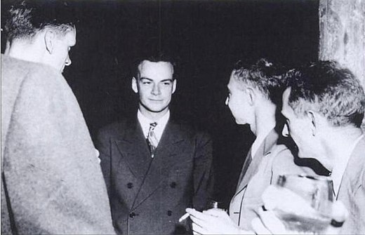 Feynman (center) with Robert Oppenheimer (immediately right of Feynman) at a Los Alamos Laboratory social function during the Manhattan Project Feynman and Oppenheimer at Los Alamos.jpg