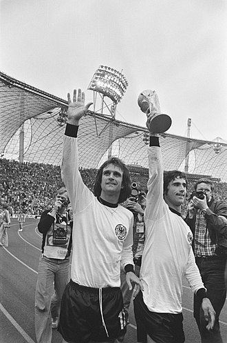 Gerd Müller - Müller (right) celebrating after winning the 1974 FIFA World Cup. To his left is Wolfgang Overath.
