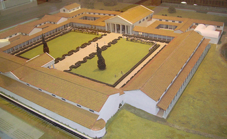 Roman gardens - Museum model of Fishbourne Roman Palace with the gardens enclosed by buildings. Archaeologists have been able to recreate the layout and analyse the plants used in the garden.