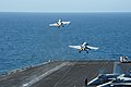 Flickr - Official U.S. Navy Imagery - Two F-A-18C Hornets launching at sea..jpg