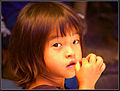 Flickr - Sukanto Debnath - a Sikkimese girl, eating pickle.jpg