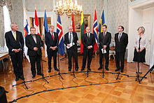 Foreign ministers standing in arc around microphones 2011