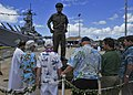 Former USS Missouri sailors bless a statue of Adm. Chester Nimitz. (9667826290).jpg