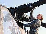 Former military police officer continues 'To Protect and Serve' as Apache aviator 140402-A-TP123-002.jpg