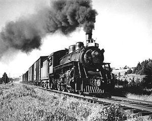 Prince Edward Island Railway - After re-gauging, the PEIR could support full-sized locomotives and trains. This example is pulling through the Maple Hill region in the spring of 1949.