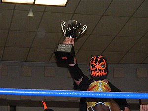 Frightmare (wrestler) - Frightmare holding the Chikara Young Lions Cup