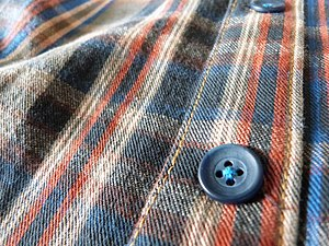 Topstitch - A shirt placket with buttons and topstitching.