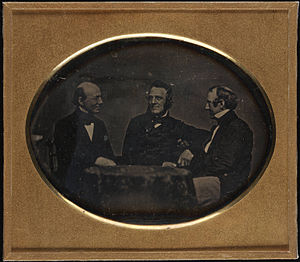 William Lloyd Garrison - Garrison and fellow abolitionists George Thompson and Wendell Phillips, seated at table, daguerreotype, ca. 1850–1851