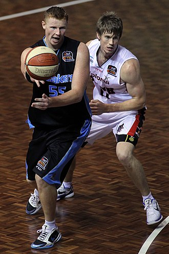 New Zealand Breakers - Breakers' Gary Wilkinson makes a pass against Wildcats' Cameron Tovey