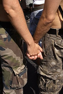 Gay Couple from back hand holding on CSD 2006 Berlin - Make Love Not War.jpg
