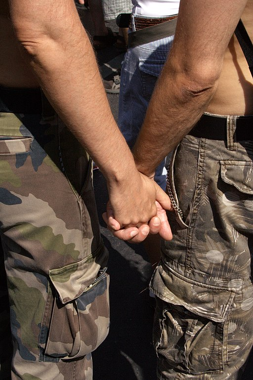 Gay Couple from back hand holding on CSD 2006 Berlin - Make Love Not War