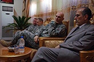 Raymond T. Odierno - Gen. Odierno and Iraqi National Security Advisor, Dr. Muwafaq Bakr al-Rubai, discuss details about Iraq's future, 29 November 2007, Mahmudiyah, Iraq.