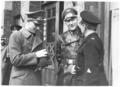 Generalkommissar Wilhelm Ritterbusch im Ledermantel.png