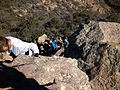 Gfp-texas-big-bend-national-park-climbing-down-the-rock.jpg