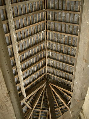 Rafter - Common rafters without collar beams form most of this roof. There is not always a ridge board or beam where the rafter tops meet. Under the midsections of the rafters are purlins which support the common rafters and are supported by principal rafters. This roof ends in an octagonal hip.