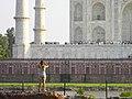 Girl photographing Taj Mahal.jpg