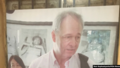 Gunnar Bergstrom pictured with a photograph of the Khmer Rouge.webp