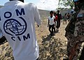 Haitian residents receive shelter packages and water distributed by the International Organization for Migration in Port-au-Prince, Haiti 100224-N-HX866-009.jpg