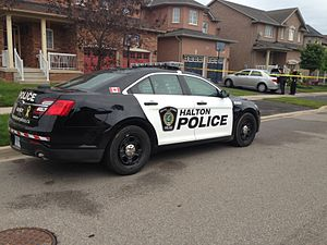 Halton Regional Police Service - This is a picture of a Halton Regional Police car with the black and white color scheme parked at a crime scene.