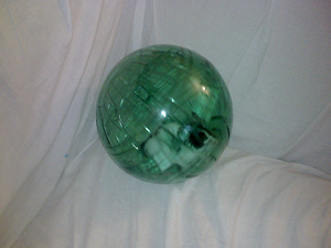 Hamster ball - A mouse in green hamster ball