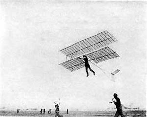 Biplane - Biplane hang glider under tow. Philadelphia, US, 1920s.