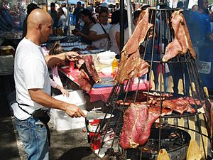 Spit barbecue meat hanging on Avenue C in the ...