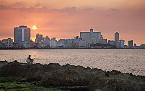 English: Fishing at the Malecon at sunset. At ...