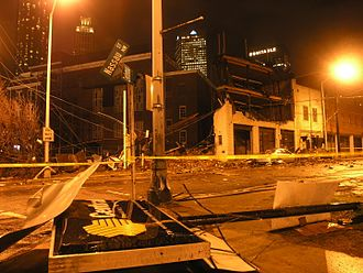 Tabernacle (concert hall) - Debris including knocked-down signs are scattered on street with the Tabernacle building in the background.