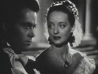 Women in film - Bette Davis and Henry Fonda in Jezebel (1938), one of the quintessential woman's films. Davis plays a Southern belle who loses her fiancé (Fonda) and her social standing when she defies conventions. She redeems herself by self-sacrifice.