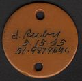ID Tag round disc with two holes worn by Irma Ruby.jpg
