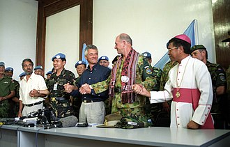 International Force East Timor - Commander INTERFET, Major General Cosgrove, joins hands with the new East Timor leadership during a celebration to mark the official handover to UNTAET.