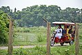 ISKCON Disciple Guiding Toto Ridden Visitors - ISKCON Campus - Mayapur - Nadia 2017-08-15 1898.JPG