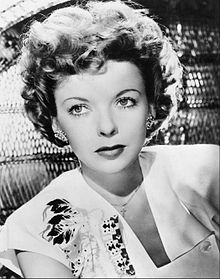 A headshot of Lupino looking up away from the camera