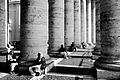 In shadows of columns of St. Peters Square (2984988366).jpg