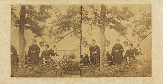 Isabel, Princess Imperial of Brazil - Isabel (center) surrounded by friends, c. 1860. The small boy seated on top of the tree is Dominique (right), son of the Countess of Barral.