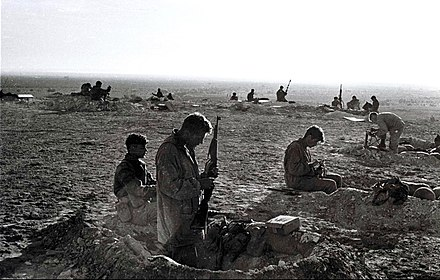 Israeli paratroopers dig in near the Parker Memorial Israeli troops in sinai war.jpg
