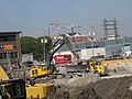 It takes this backhoe five buckets to load one of it dump trucks, 2015 09 23 (2).JPG - panoramio.jpg